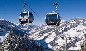 Snowy mountains with ski liftss